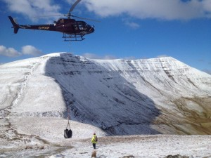 A helicopter airlifts materials to repair footpaths onto Fan y Big, one of the peaks in the central Beacons - photo credit - Sam Harpur