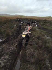 A motorbike seized for illegal off-roading, photo shows the damage the activity causes to the landscape.