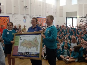 Ysgol Bro Tawe receiving their award and map board.