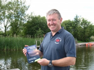 Garnet Davies, a Llangorse and Bwlch Alliance Volunteer with the 'Awesome Walks' guide produced by the group